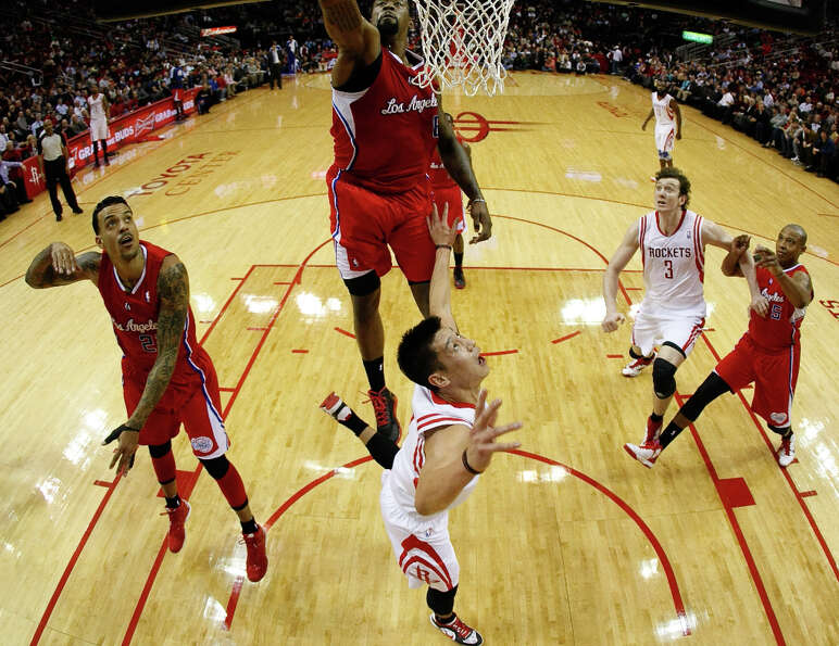 Rockets guard Jeremy Lin looks to see if Clippers center DeAndre Jordan will block his shot during t