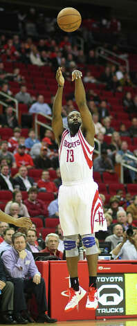 Rockets guard James Harden makes a 3-pointer in the first quarter. Photo: Nick De La Torre / © 2013  Houston Chronicle