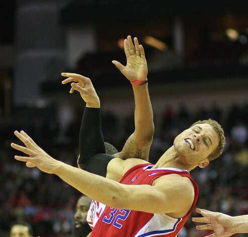 Clipper forward Blake Griffin has to work hard to get position as Rockets forward Marcus Morris defends him in the post during the second quarter. Photo: Nick De La Torre / © 2013  Houston Chronicle