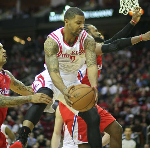 Rockets forward Marcus Morris gets a rebound over Ronny Turiaf of the Clippers. Photo: Nick De La Torre / © 2013  Houston Chronicle