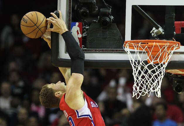 Clippers forward Blake Griffin mishandles an aley-oop dunk during the first quarter. Photo: Nick De La Torre / © 2013  Houston Chronicle