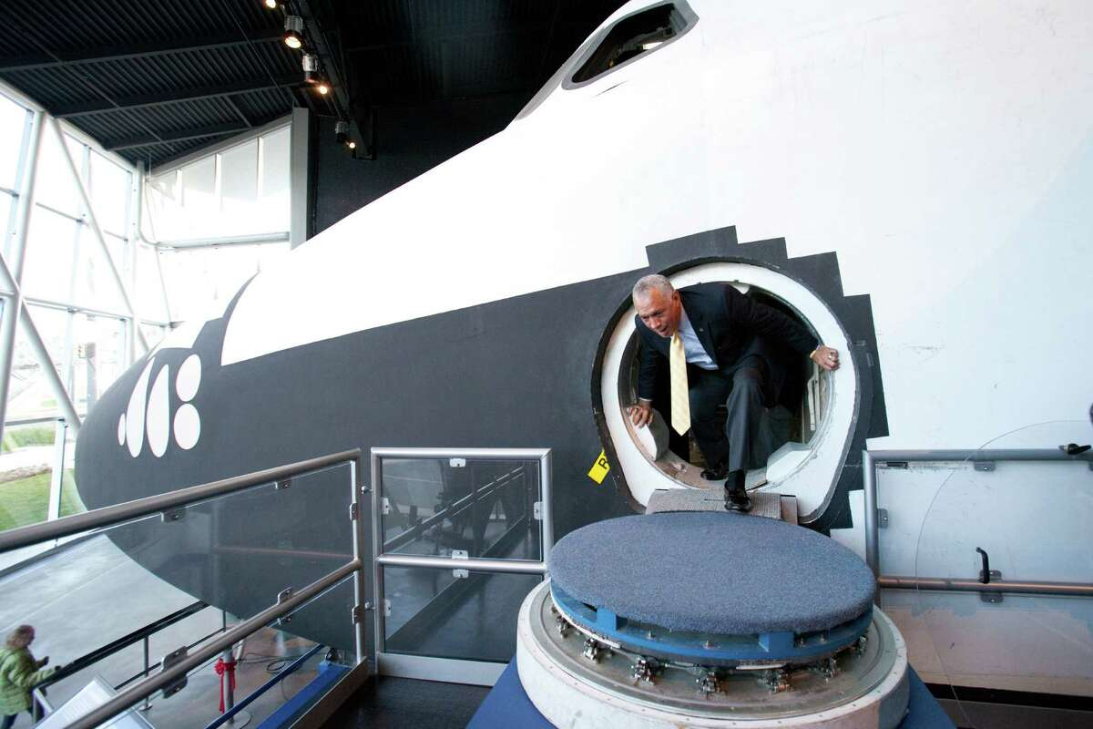 NASA Administrator Charles Bolden exits the Space Shuttle's Full Fuselage Trainer on Tuesday, January 15, 2013 during a tour in the Charles Simonyi Space Gallery at the Museum of Flight in Seattle. The former astronaut trained in the shuttle mock-up.