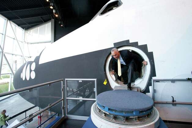NASA Administrator Charles Bolden exits the Space Shuttle's Full Fuselage Trainer on Tuesday, January 15, 2013 during a tour in the Charles Simonyi Space Gallery at the Museum of Flight in Seattle. The former astronaut trained in the shuttle mock-up. Photo: JOSHUA TRUJILLO, SEATTLEPI.COM / SEATTLEPI.COM
