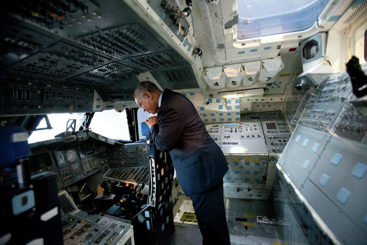 NASA Administrator Charles Bolden remembers his own time training in the Space Shuttle's Full Fuselage Trainer on Tuesday, January 15, 2013 during a tour of the trainer in the Charles Simonyi Space Gallery at the Museum of Flight in Seattle. The head of NASA was touring the facility on Tuesday.
