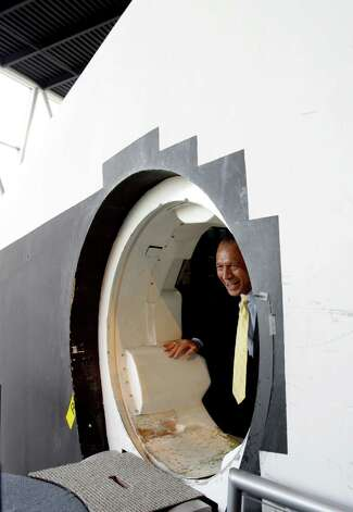 NASA Administrator Charles Bolden exits the Space Shuttle's Full Fuselage Trainer during a tour in the Charles Simonyi Space Gallery at the Museum of Flight in Seattle. Photo: Ted Huetter, Museum Of Flight / Museum of Flight