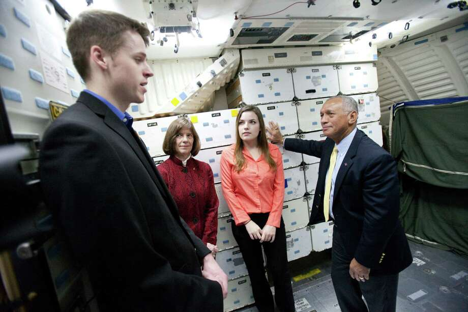 NASA Administrator Charles Bolden, right, speaks with, from left, Alec Lindsey, a graduate student that studied unmanned aircraft systems operation, former NASA astronaut Bonnie Dunbar and Brenna Tuller-Ross, a UW earth and space sciences student inside the crew compartment of the Space Shuttle Full Fuselage Trainer. Photo: JOSHUA TRUJILLO, SEATTLEPI.COM / SEATTLEPI.COM