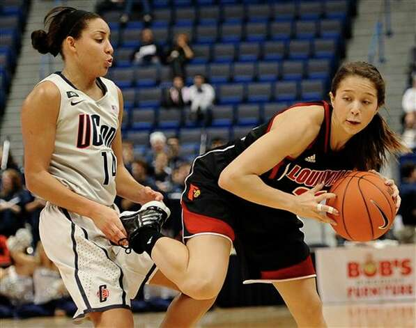 Bria Hartley, left, grabs the foot of Louisville's Jude Schimmel, as Schimmel catches a pass, during the second half of an NCAA college basketball game in Hartford, Conn., Tuesday, Jan. 15, 2013. (AP Photo/Jessica Hill)