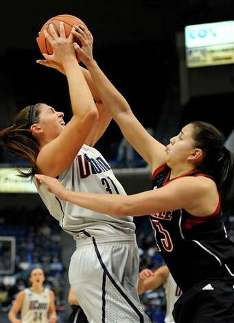 UConn's Stefanie Dolson, left, is pressured by Louisville's Shoni Schimmel, during the first half of an NCAA college basketball game in Hartford, Conn., Tuesday, Jan. 15, 2013. (AP Photo/Jessica Hill)