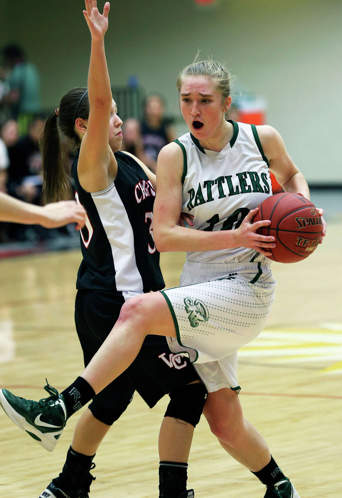 Wendy Knight tugs away a pass for the Rattlers as the Reagan girls play Churchill at Littleton Gym on January 15, 2013.