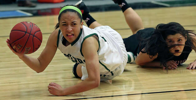 Rattler guard Mailee Jones grabs a loose ball on the floor and tries a pass in the lane after leaving Bailee Weinheimer behind as the Reagan girls play Churchill at Littleton Gym on January 15, 2013. Photo: Tom Reel, San Antonio Express-News / ©2012 San Antono Express-News