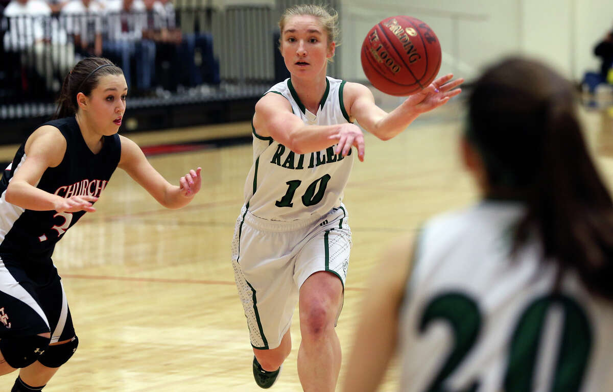 Wendy Knight passes off the point for the Rattlers as the Reagan girls play Churchill at Littleton Gym on January 15, 2013.