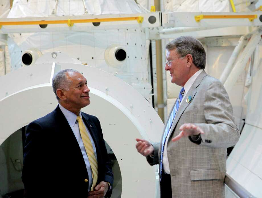 NASA Administrator Charles Bolden meets with The Museum of Flight President and CEO Doug King in the cargo bay of theSpace Shuttle Full Fuselage Trainer. Photo: Ted Huetter, Museum Of Flight / Museum of Flight