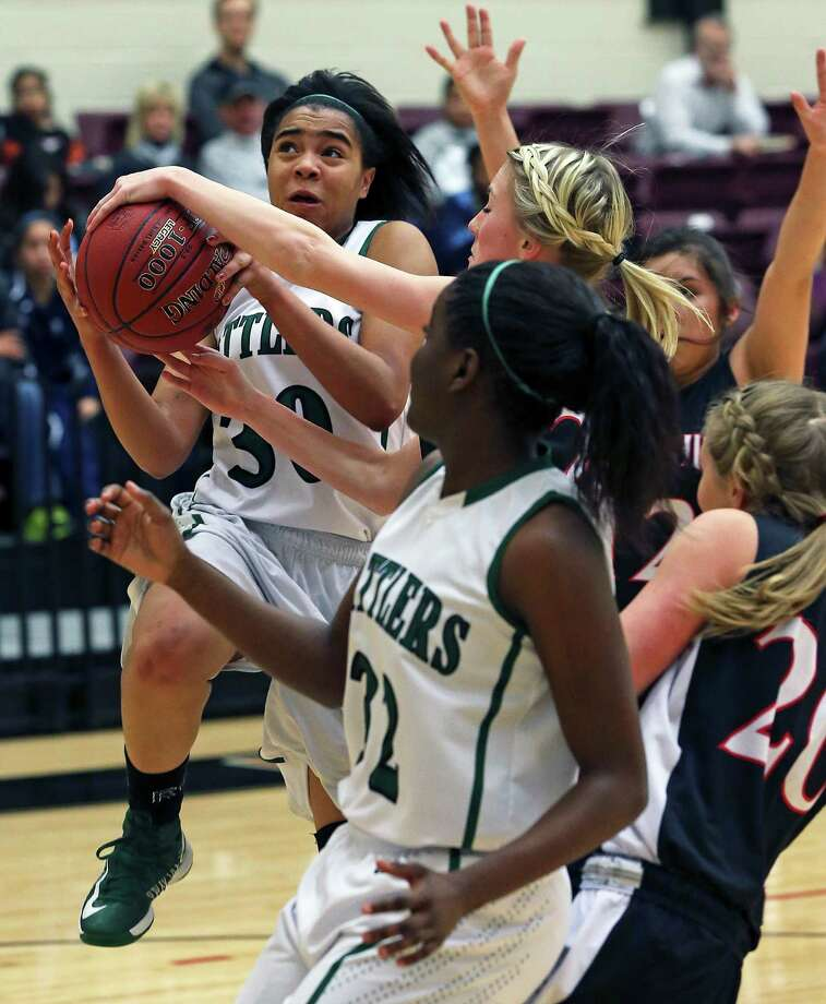 Rattler forward Briana Gladney powers into a foul in the lane off a fastbreak as the Reagan girls play Churchill at Littleton Gym on January 15, 2013. Photo: Tom Reel, San Antonio Express-News / ©2012 San Antono Express-News