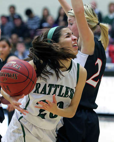 Rattler guard Tessa Ramirez gets fouled on a drive as the Reagan girls play Churchill at Littleton Gym on January 15, 2013. Photo: Tom Reel, San Antonio Express-News / ©2012 San Antono Express-News