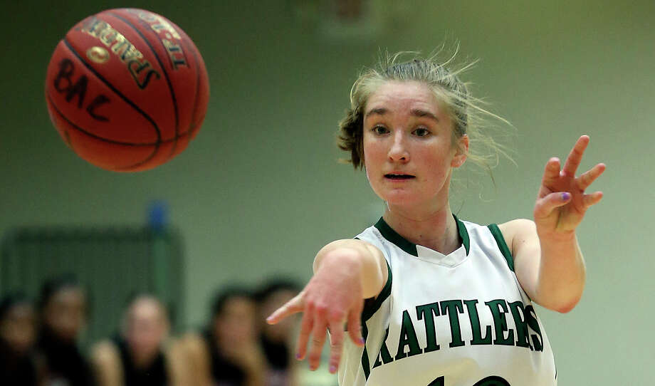 Wendy Knight passes for the Rattlers as the Reagan girls play Churchill at Littleton Gym on January 15, 2013. Photo: Tom Reel, San Antonio Express-News / ©2012 San Antono Express-News