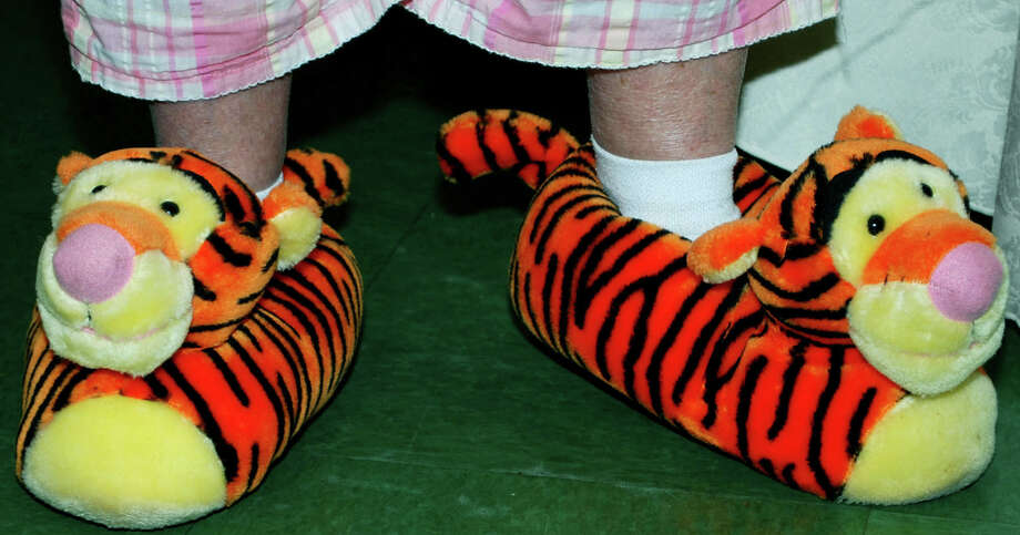 Tigger slippers, worn proudly by Pat Hammer, catch the eye of guests of the New Yearís pajama party hosted Jan. 4, 2013, by the New Milford Senior Center. Photo: Deborah Rose