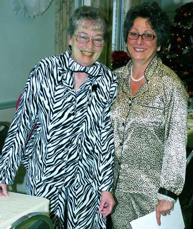 The eye-catching animal print pajamas of Judith Villani, left, and Carolyn Haglund, director of the New Milford Senior Center, earn the spotlight during the New Yearís pajama party held Jan. 4, 2013, at the New Milford Senior Center. Photo: Deborah Rose