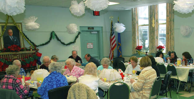 The dining hall at the New Milford Senior Center was decorated  to the hilt and packed with festive patrons for the New Yearís pajama party held Jan. 4, 2013. Photo: Deborah Rose