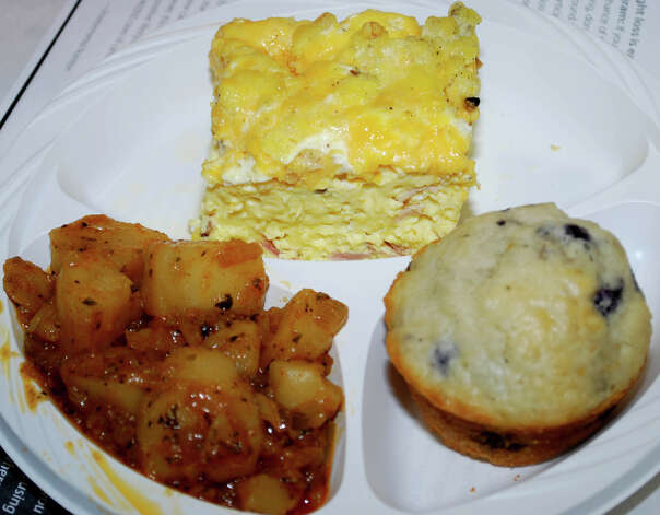 The main course features ham and cheddar frittata, home fries and a blueberry muffin, made by students of the Community Culinary School of Northwest Connecticut based in New Milford, for the New Yearís pajama party held Jan. 4, 2013, at the New Milford Senior Center. Photo: Deborah Rose