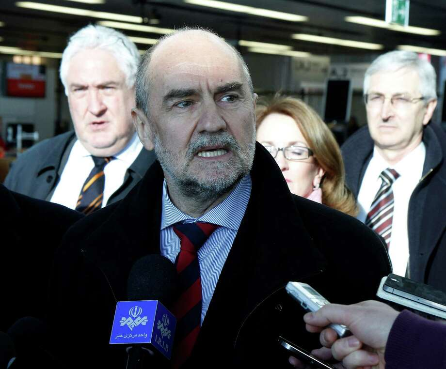 Herman Nackaerts, center, of the International Atomic Energy Agency, IAEA, Deputy Director General and Head of the Department of Safeguards, speaks to the press before his flight to Iran at Vienna's Schwechat airport, Austria, Tuesday, Jan. 15, 2013. The U.N. team is embarking on a new try to restart its probe into suspicions that Iran secretly worked on nuclear arms. (AP Photo/Ronald Zak) Photo: Ronald Zak