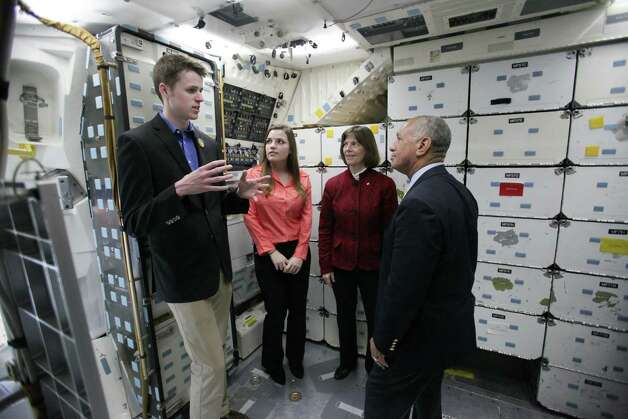NASA Administrator Charles Bolden, right, speaks with, from left, Alec Lindsey, a graduate student that studied unmanned aircraft systems operation, Brenna Tuller-Ross, a UW earth and space sciences student, and former NASA astronaut Bonnie Dunbar inside the crew compartment of the Space Shuttle Full Fuselage Trainer. Photo: JOSHUA TRUJILLO, SEATTLEPI.COM / SEATTLEPI.COM
