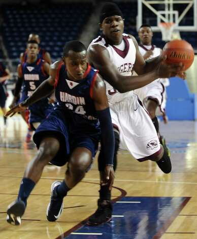 HJ player Braiden Harmon, #24, tries to stop Silsbee player Davaughn Thomas, #32, during the Silsbee High School boys basketball game against Hardin Jefferson High School on Tuesday, January 15, 2013, at Ford Arena in Beaumont. Photo taken: Randy Edwards/The Enterprise