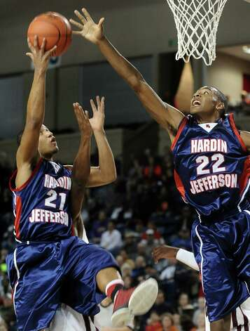 HJ players Travis Stevens, #21, and Dylan Mays, #22, go for a rebound during the Silsbee High School boys basketball game against Hardin Jefferson High School on Tuesday, January 15, 2013, at Ford Arena in Beaumont. Photo taken: Randy Edwards/The Enterprise