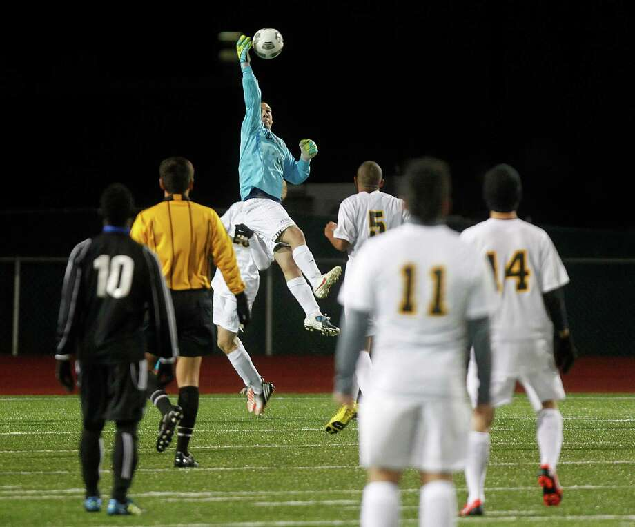 Elsik's goalie Obed Mena makes a stop as Elsik High School defeated Klein Oak 2-1 at Butch Theiss Field at Klein Tuesday, Jan. 15, 2013, in Houston. Photo: Johnny Hanson, Houston Chronicle / © 2013  Houston Chronicle