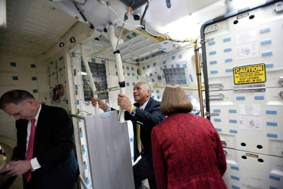 NASA Administrator Charles Bolden, center, ascends a ladder onto the flight deck inside the crew compartment of the Space Shuttle Full Fuselage Trainer. Photo: JOSHUA TRUJILLO, SEATTLEPI.COM / SEATTLEPI.COM