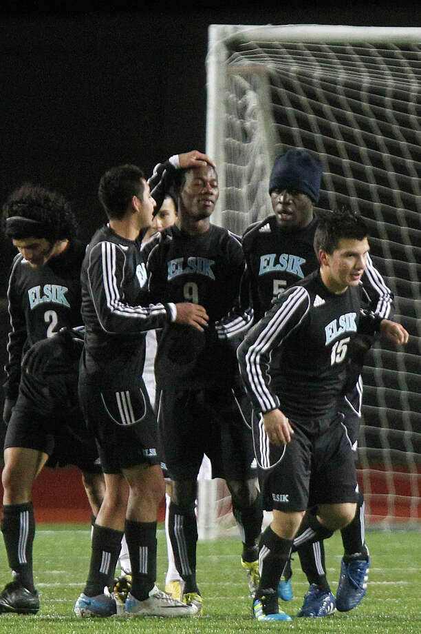 Kayode George (9) is congratulated by his Elsik teammates after he scored the first of two goals as Elsik High School defeated Klein Oak 2-1 at Butch Theiss Field at Klein Tuesday, Jan. 15, 2013, in Houston. Photo: Johnny Hanson, Houston Chronicle / © 2013  Houston Chronicle