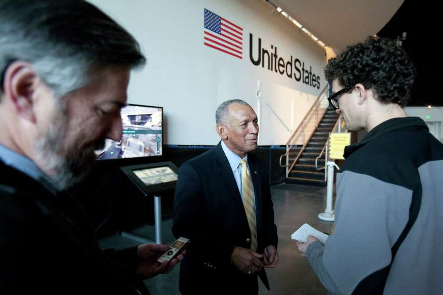 NASA Administrator Charles Bolden meets with reporters next to the Space Shuttle's Full Fuselage Tra