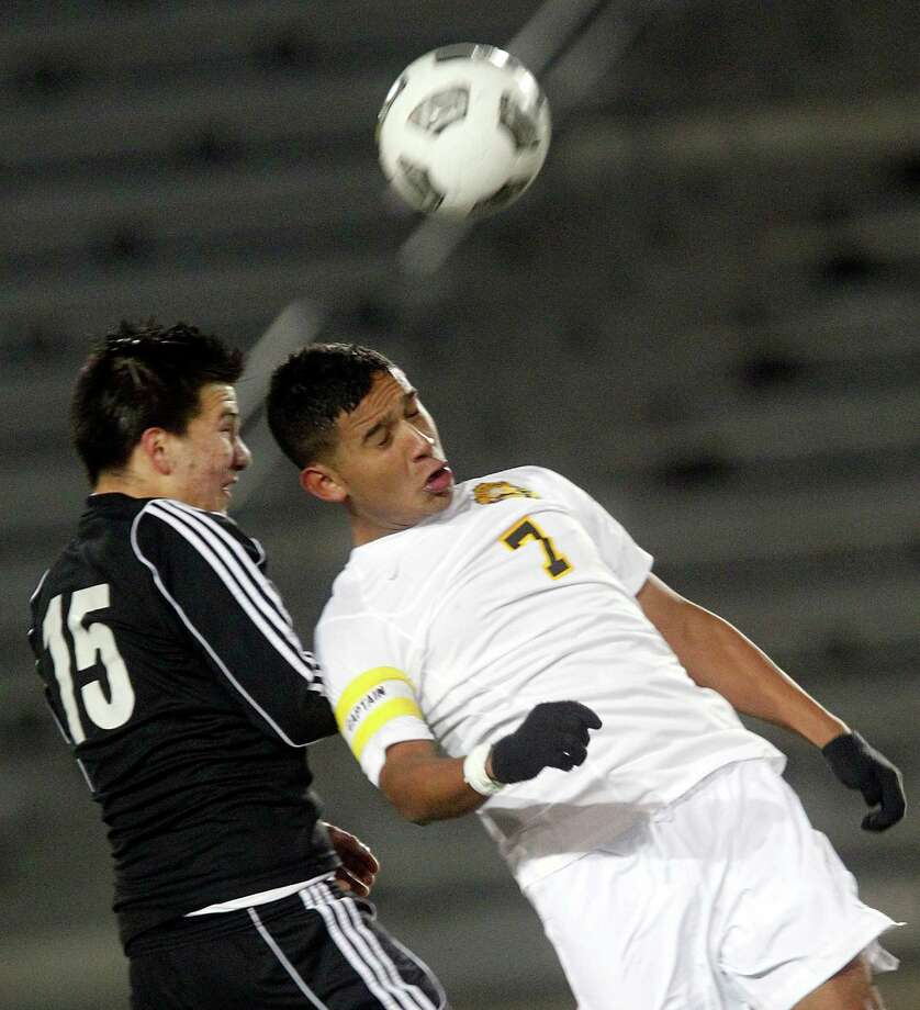 Elsik's Federico Sosa (15) and Klein Oak's Cesar Narvaez (7) battle for the ball as Elsik High School defeated Klein Oak 2-1 at Butch Theiss Field at Klein Tuesday, Jan. 15, 2013, in Houston. Photo: Johnny Hanson, Houston Chronicle / © 2013  Houston Chronicle