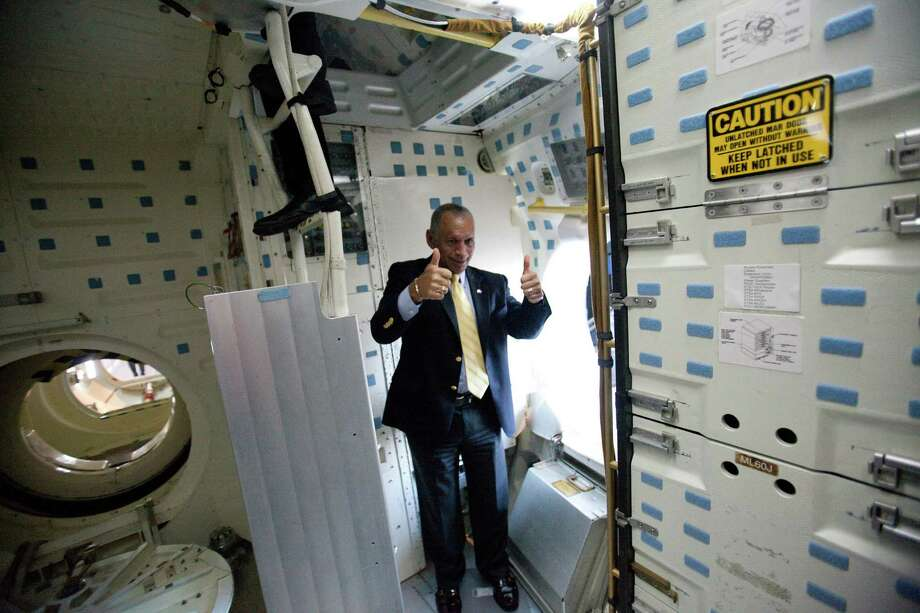 NASA Administrator Charles Bolden gives a thumbs up in the Space Shuttle's Full Fuselage Trainer on Tuesday, January 15, 2013 during a tour in the Charles Simonyi Space Gallery at the Museum of Flight in Seattle. The head of NASA was touring the facility on Tuesday. Photo: JOSHUA TRUJILLO, SEATTLEPI.COM / SEATTLEPI.COM