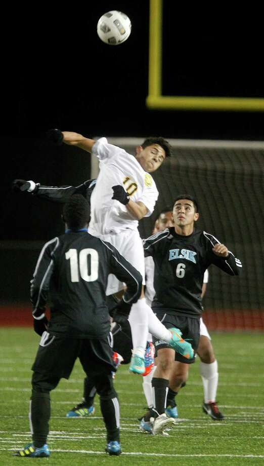 Klein Oak's Christhian Melgar (10) heads the ball over Elsik's Brandon Loza (6) and Aniekan Williams (10) as Elsik High School defeated Klein Oak 2-1 at Butch Theiss Field at Klein Tuesday, Jan. 15, 2013, in Houston. Photo: Johnny Hanson, Houston Chronicle / © 2013  Houston Chronicle