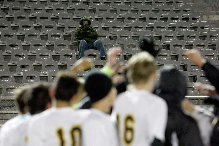 Mike Howard, whose son, Chris Howard plays for Klein Oak, watches from otherwise empty stands in 30-degree weather as Elsik High School defeated Klein Oak 2-1 at Butch Theiss Field at Klein Tuesday, Jan. 15, 2013, in Houston. Photo: Johnny Hanson, Houston Chronicle / © 2013  Houston Chronicle