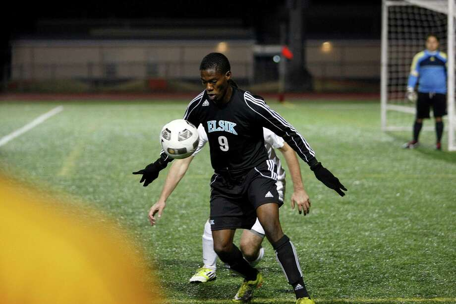 Kayode George (9) of Elsik moves the ball down the field as Elsik High School defeated Klein Oak 2-1 at Butch Theiss Field at Klein Tuesday, Jan. 15, 2013, in Houston. Photo: Johnny Hanson, Houston Chronicle / © 2013  Houston Chronicle