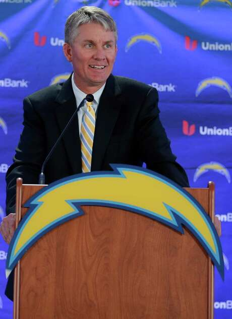 Mike McCoy speaks during a news conference after being named the new head coach of the San Diego Chargers NFL football team Tuesday, Jan. 15, 2013, in San Diego. The former offensive coordinator for the Denver Broncos replaces Norv Turner, who was fired along with general manager A.J. Smith after the Chargers finished 7-9 and missed the playoffs for the third straight season. (AP Photo/Gregory Bull) Photo: Gregory Bull, STF / AP