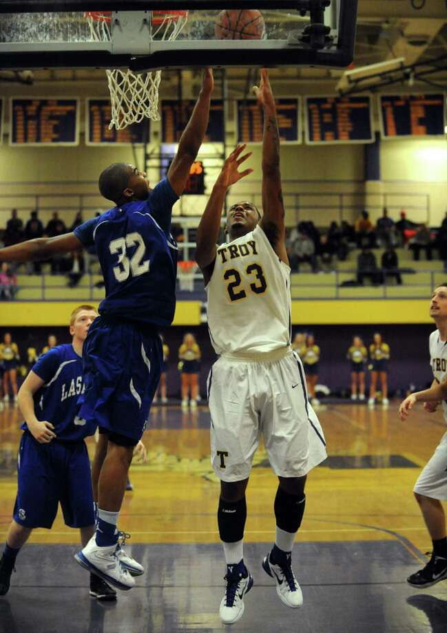 Troy's Jerrell Reid goes to the basket defended by LaSalle's Elijah Burns during their boy's high school basketball game on Tuesday Jan. 15,2013 in Troy, N.Y. (Michael P. Farrell/Times Union) Photo: Michael P. Farrell
