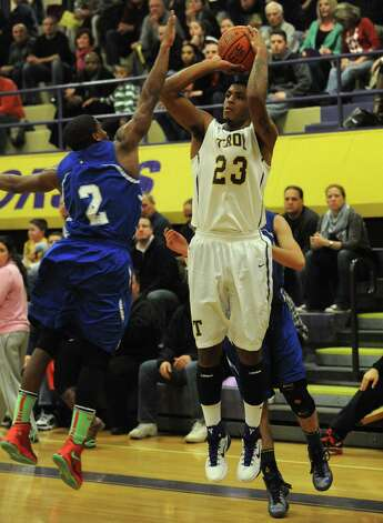 Troy's Jerrell Reid shoots a three point shot  during their boy's high school basketball game against LaSalle on Tuesday Jan. 15,2013 in Troy, N.Y. (Michael P. Farrell/Times Union) Photo: Michael P. Farrell