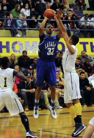 LaSalle's Elijah Burns takes a shot during their boy's high school basketball game against Troy on Tuesday Jan. 15,2013 in Troy, N.Y. (Michael P. Farrell/Times Union) Photo: Michael P. Farrell