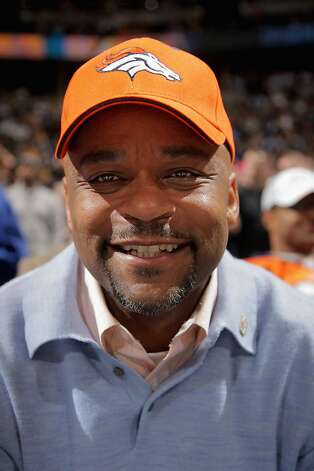 DENVER, CO - JANUARY 13: Denver Mayor Michael Hancock wears as Denver Broncos hat as he watches from courtside seats as the Denver Nuggets defeated the Miami Heat 117-104 at the Pepsi Center on January 13, 2012 in Denver, Colorado. NOTE TO USER: User expressly acknowledges and agrees that, by downloading and or using this photograph, User is consenting to the terms and conditions of the Getty Images License Agreement. (Photo by Doug Pensinger/Getty Images) DENVER, CO - JANUARY 13:  Denver Mayor Michael Hancock wears as Denver Broncos hat as he watches from courtside seats as the Denver Nuggets defeated the Miami Heat 117-104 at the Pepsi Center on January 13, 2012 in Denver, Colorado. NOTE TO USER: User expressly acknowledges and agrees that, by downloading and or using this photograph, User is consenting to the terms and conditions of the Getty Images License Agreement.  (Photo by Doug Pensinger/Getty Images) Photo: Doug Pensinger, Getty Images