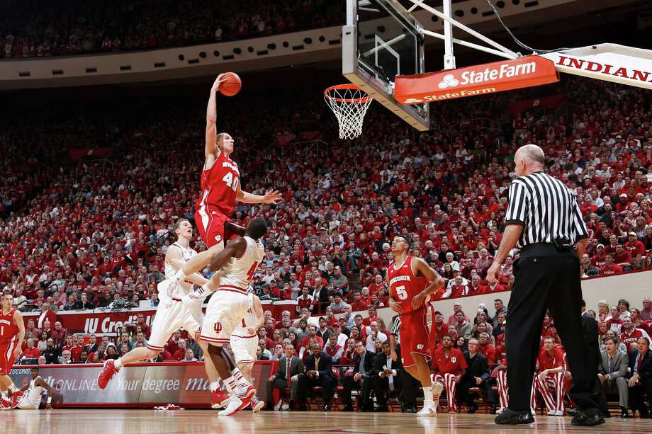 Wisconsin's Jared Berggren soars over Indiana's Victor Oladipo for a dunk Tuesday night. Photo: Joe Robbins, Stringer / 2013 Getty Images