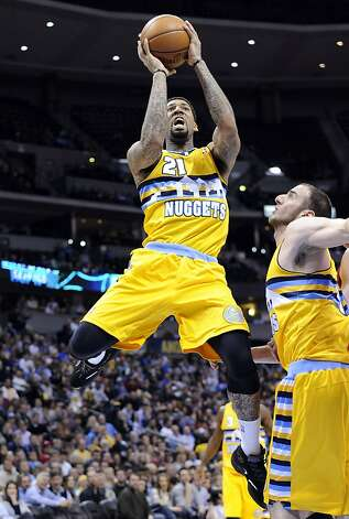 Denver's Wilson Chandler shoots in the third quarter. He hit a key three in OT. Photo: Jack Dempsey, Associated Press