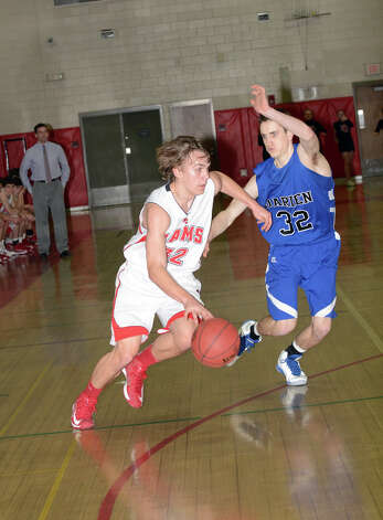 New Canaan's Erik Jager (32) controls the ball as Darien's Ian Burgoyne (32) defends during the boys basketball at New Canaan High School on Tuesday, Jan. 15, 2013. Photo: Amy Mortensen / Connecticut Post Freelance