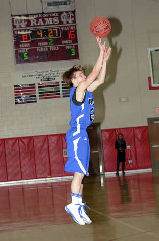 Darien's Matt Staubi (21) takes a shot during the boys basketball against New Canaan High School at New Canaan High School on Tuesday, Jan. 15, 2013. Photo: Amy Mortensen / Connecticut Post Freelance