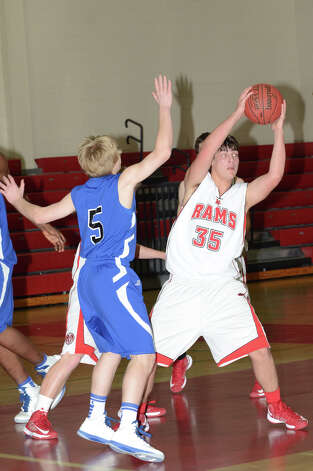 New Canaan's Beau Santero (35) controls the ball as Darien's Bobby Fitzpatrick (5) defends during the boys basketball at New Canaan High School on Tuesday, Jan. 15, 2013. Photo: Amy Mortensen / Connecticut Post Freelance