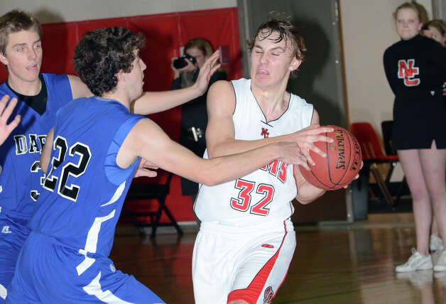 New Canaan's Erik Jager (32) controls the ball as Darien's Henry Baldwin (22) defends during the boys basketball at New Canaan High School on Tuesday, Jan. 15, 2013. Photo: Amy Mortensen / Connecticut Post Freelance