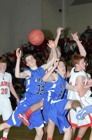 Darien and New Canaan go up for a rebound during the boys basketball at New Canaan High School on Tuesday, Jan. 15, 2013. Photo: Amy Mortensen / Connecticut Post Freelance