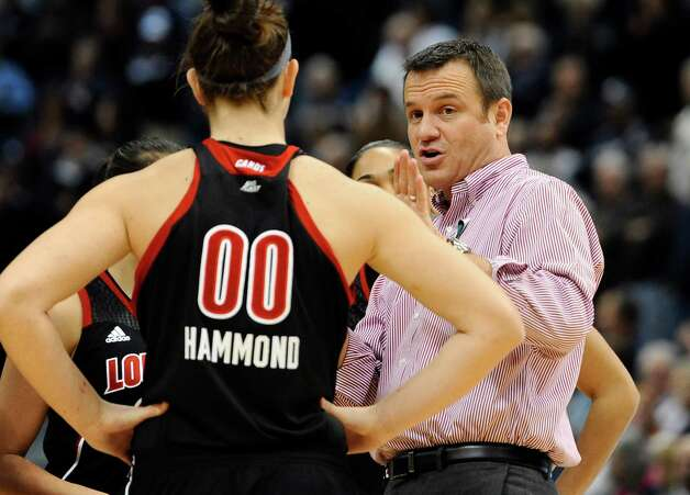 Louisville head coach Jeff Walz, right, speaks with Louisville's Sara Hammond (00) prior to tip-off of an NCAA college basketball game against Connecticut  in Hartford, Conn., Tuesday, Jan. 15, 2013. Photo: Jessica Hill