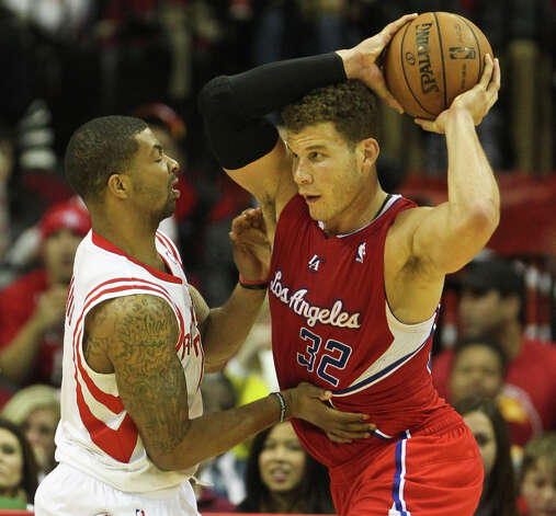 Rockets forward Marcus Morris has trouble guarding Clippers forward Blake Griffin during the fourth quarter. Photo: Nick De La Torre / © 2013  Houston Chronicle